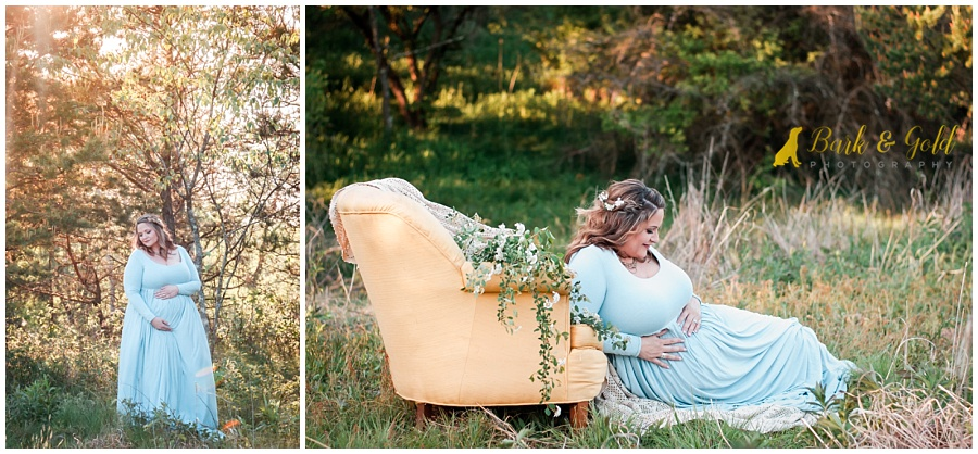 beautiful mother-to-be examines belly during maternity shoot at Hillman State Park