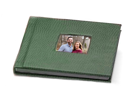 fine art album with photo cut-out cover featuring engaged couple