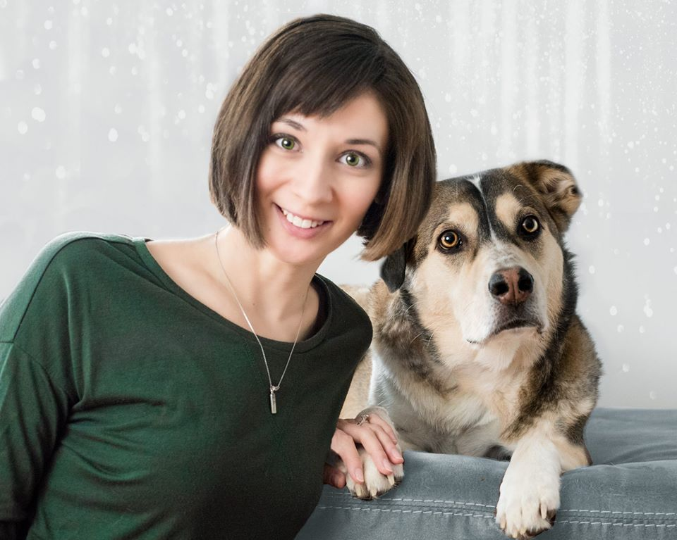 head shot of jessica wasik with siberian retriever dog