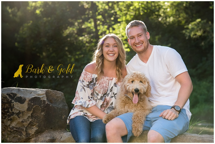 goldendoodle puppy posing with family at Brady's Run Park in Beaver County