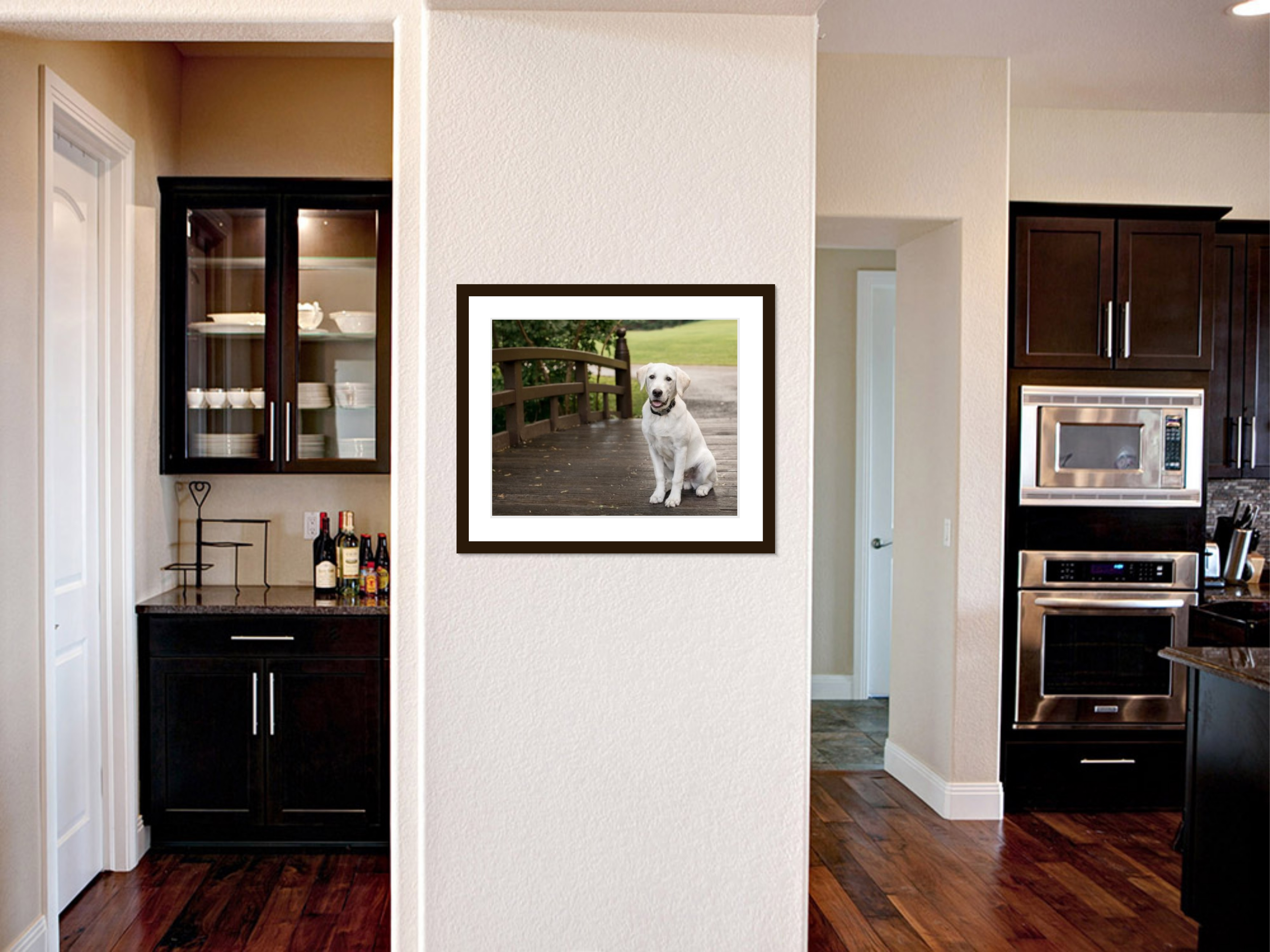 framed wall art of a puppy on kitchen walls