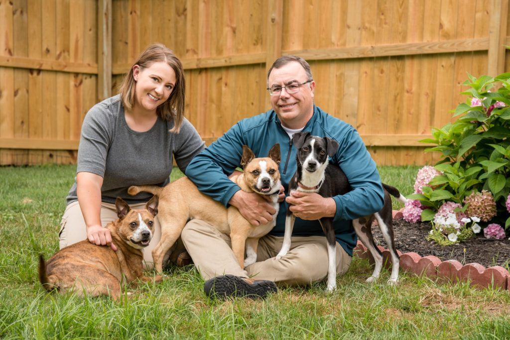 three rescued mutts and their owners during a backyard session in the North Hills of Pittsburgh