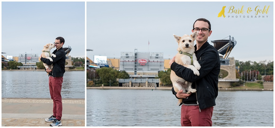 Cairn terrier mix with human brother on Pittsburgh's North Shore with Heinz Field in the background