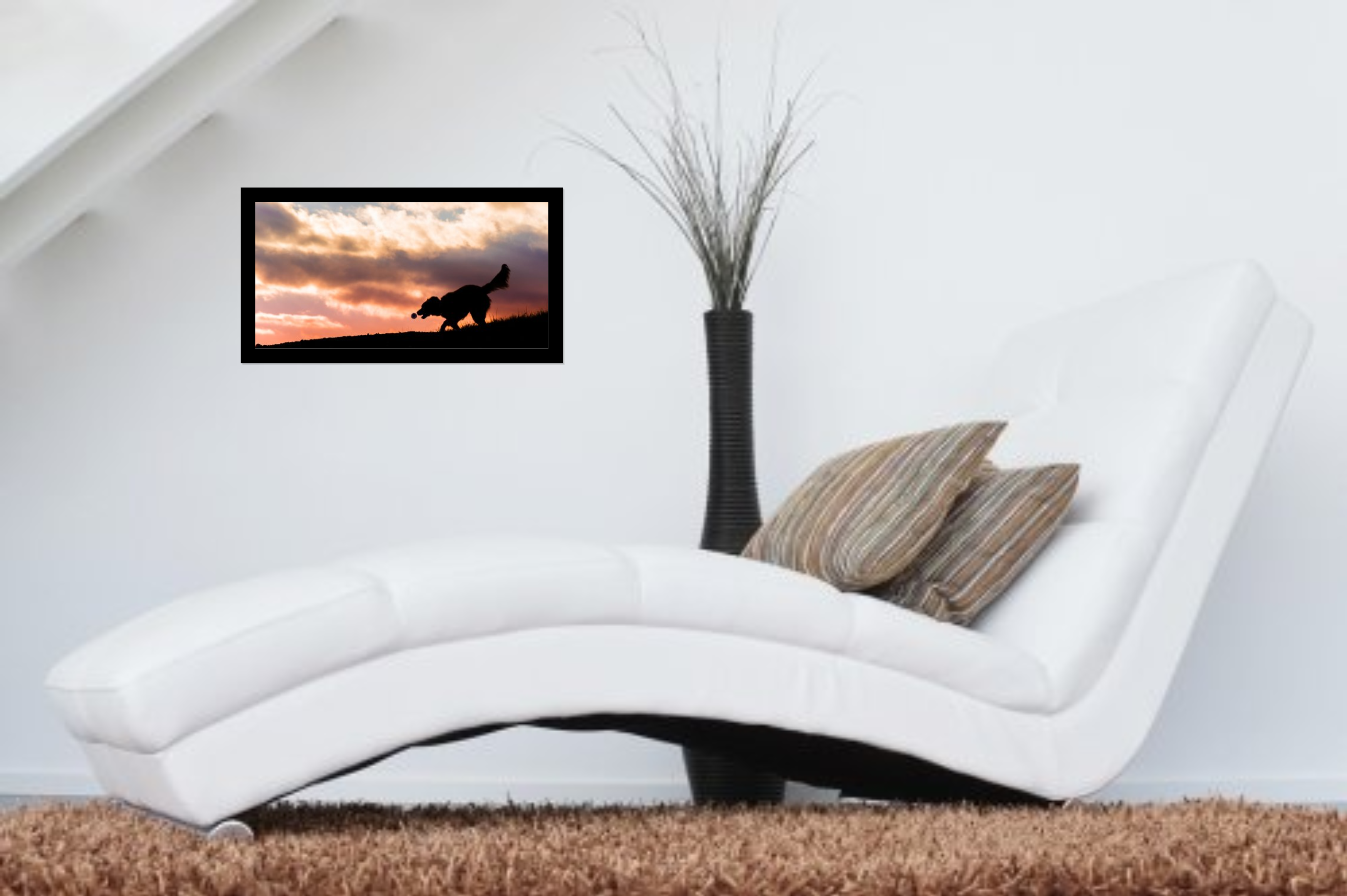 framed acrylic wall art above a white sofa