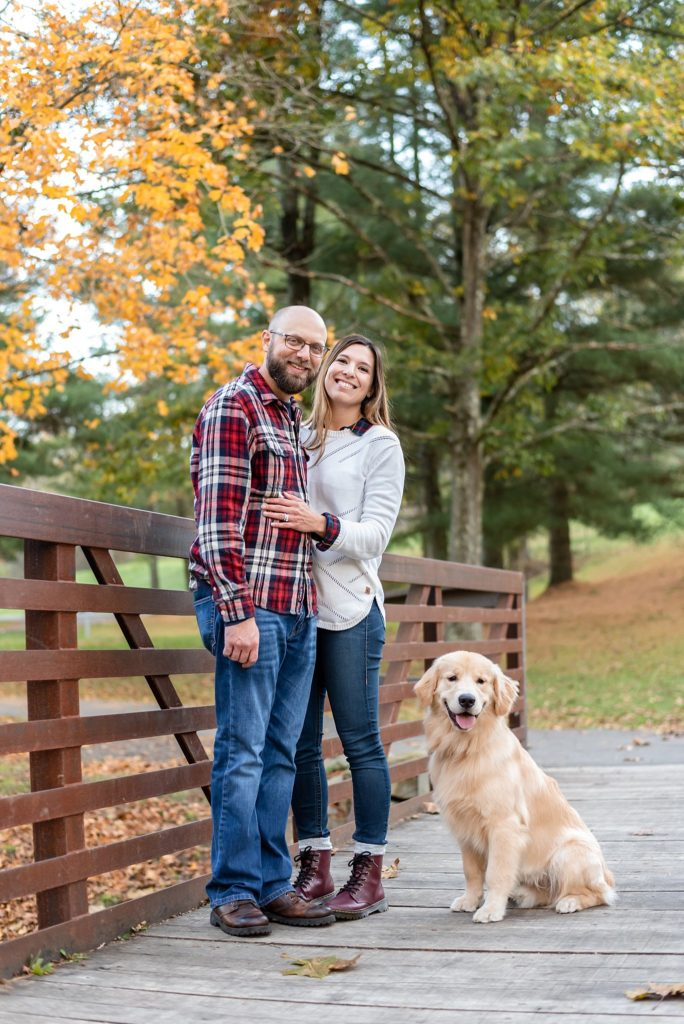 young couple with their golden retriever puppy at Mingo Creek Park